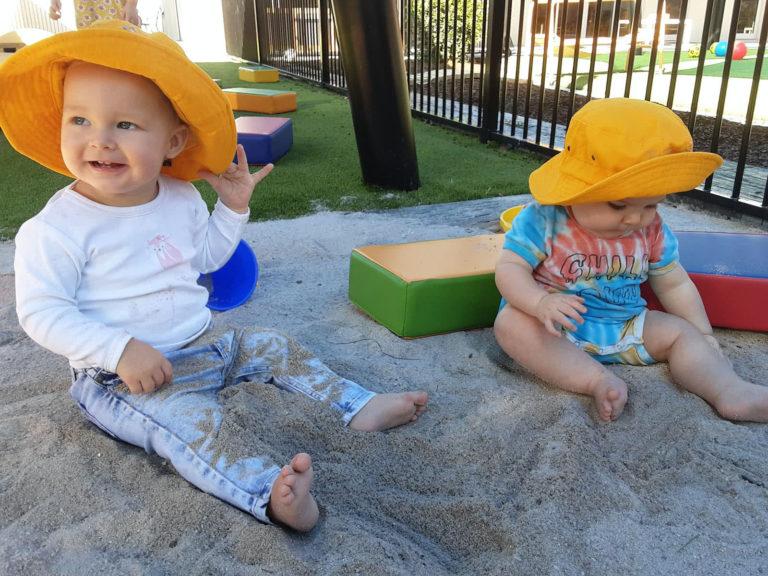 Babies In A Sandpit