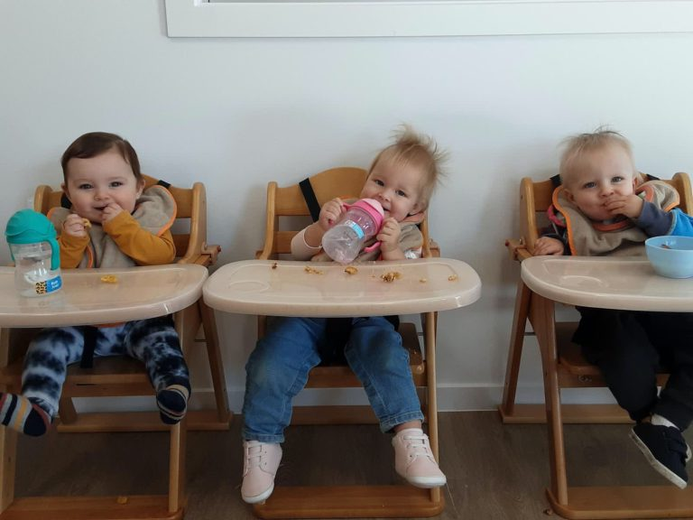 Babies In Highchairs Snack Time