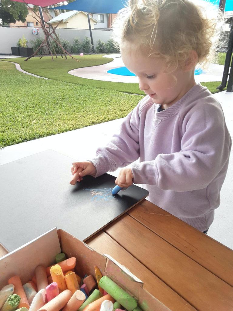 Kindy Kid With Chalk Board