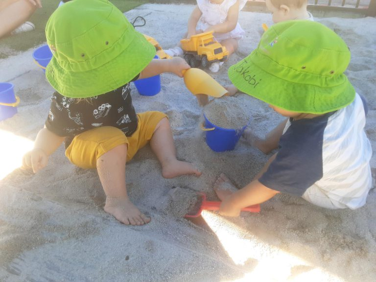 Toddlers In The Sandpit